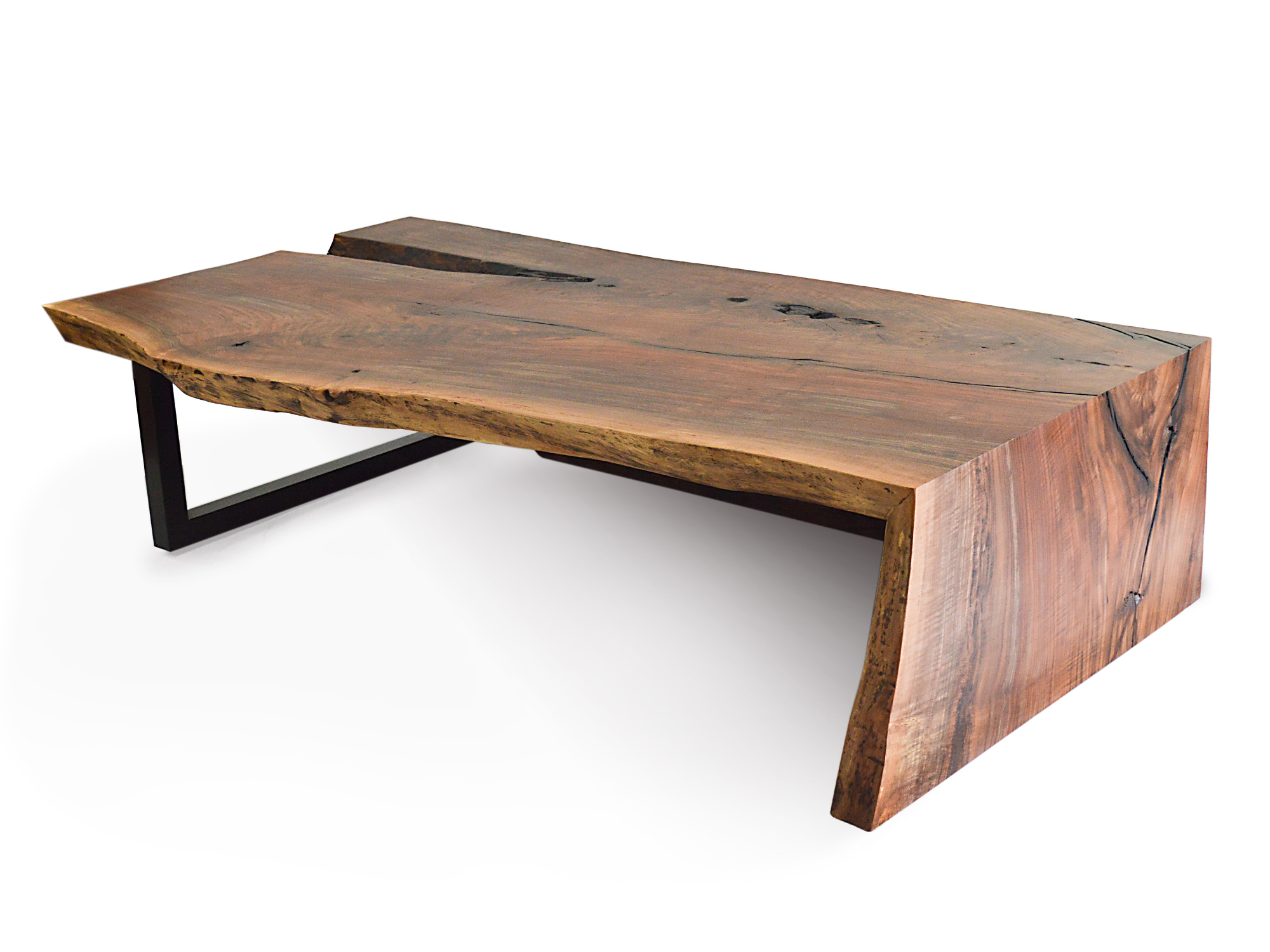 A custom living room coffee table behind the process rotsen furniture Handcrafted coffee table
